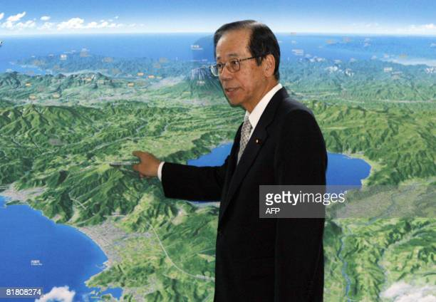 Japanese Prime Minister Yasuo Fukuda points out the location of the Windsor hotel the venue of the G8 Hokkaido Toyako Summit on a map at his official...