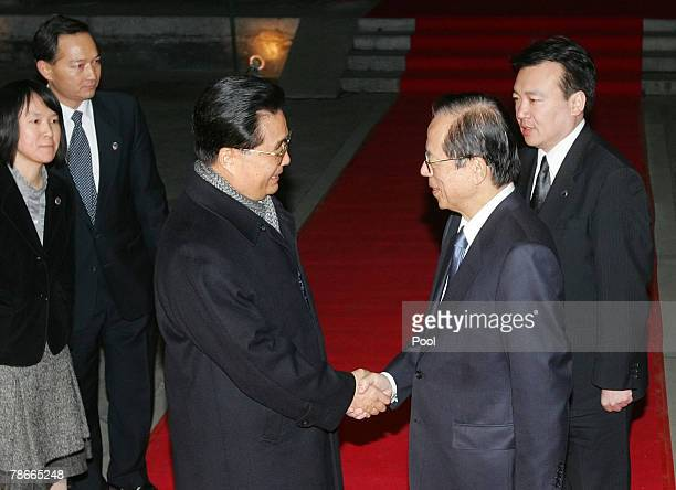 Japanese Prime Minister Yasuo Fukuda shakes hands with Chinese President Hu Jintao at Beijing's Diaoyutai State Guesthouse on December 28 2007 in...