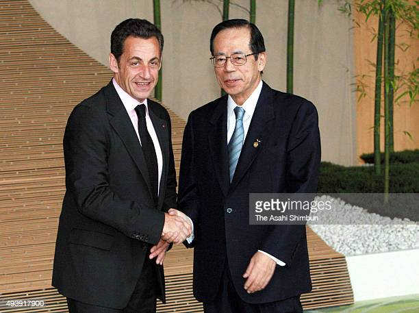 Japanese Prime Minister Yasuo Fukuda welcomes French President Nicolas Sarkozy during the G8 Summit on July 7 2008 in Toyako Hokkaido Japan