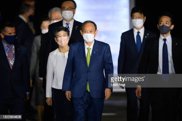 Japanese Prime Minister Yoshihide Suga and his wife Mariko Suga arrive at Newquay Airport on June 11, 2021 in Newquay, England. UK Prime Minister,...