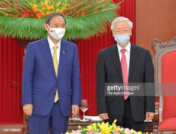 Japanese Prime Minister Yoshihide Suga and Nguyen Phu Trong, General Secretary of the Communist Party of Vietnam pose for photographs prior to their...