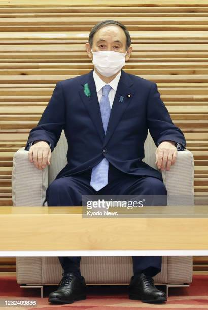 Japanese Prime Minister Yoshihide Suga attends a Cabinet meeting in Tokyo on April 20, 2021.