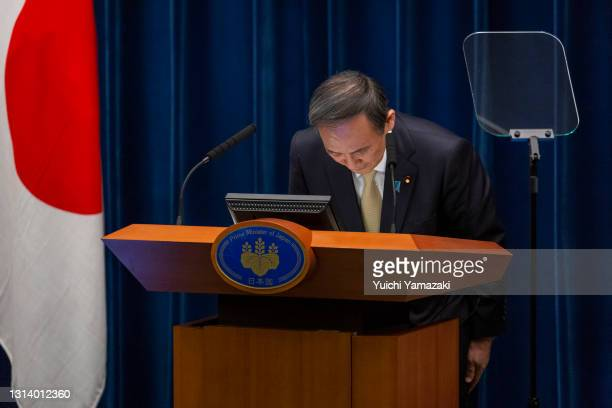 Japanese Prime Minister Yoshihide Suga bows during a press conference on April 23, 2021 in Tokyo, Japan. Japanese Prime Minister Yoshihide Suga has...