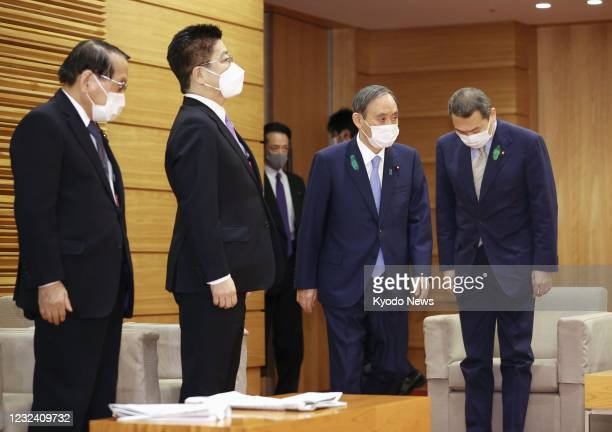 Japanese Prime Minister Yoshihide Suga prepares to attend a Cabinet meeting in Tokyo on April 20, 2021.