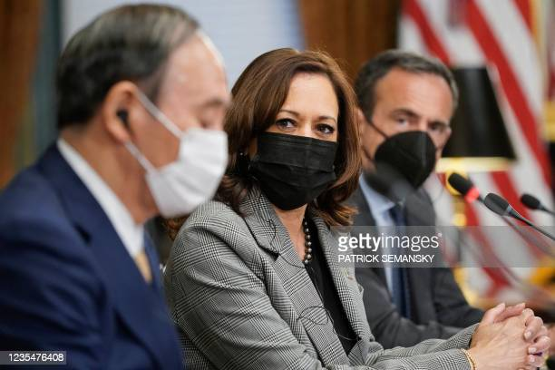 Japanese Prime Minister Yoshihide Suga speaks as he meets with Vice President Kamala Harris and Australian Prime Minister Scott Morrison in the Vice...