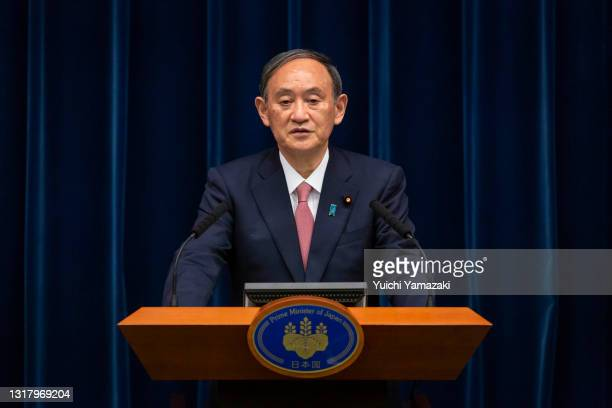Japanese Prime Minister Yoshihide Suga speaks during a press conference at the Prime Minister's official residence on May 14, 2021 in Tokyo, Japan....