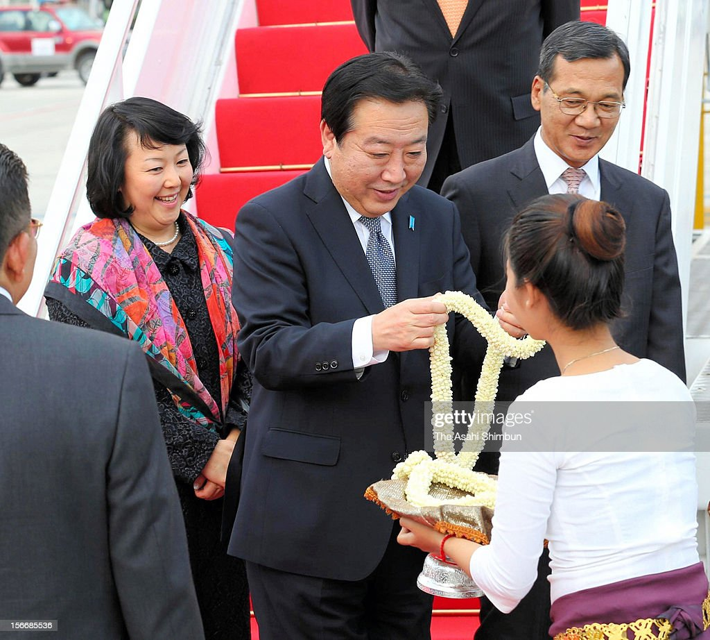 Japanese Prime Minister Yoshihiko Noda and his wife Hitomi are seen upon arrival at Phnom Penh International Airport on November 18, 2012 in Phnom Penh, Cambodia. PM Noda is in Combodia to attend the ASEAN (Association of South]East Asian Nations) meeting, also to meet U.S. president Barack Obama and attend the East Asian Summit.
