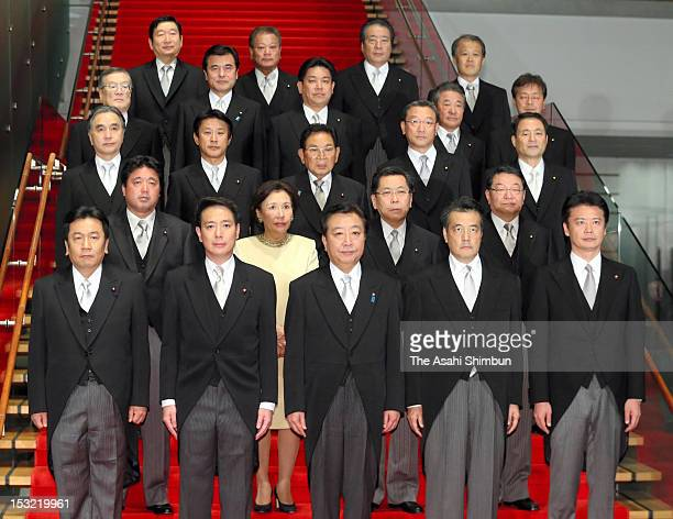 Japanese Prime Minister Yoshihiko Noda and other cabinet members pose for photographs at Noda's official residence on October 1 2012 in Tokyo Japan...
