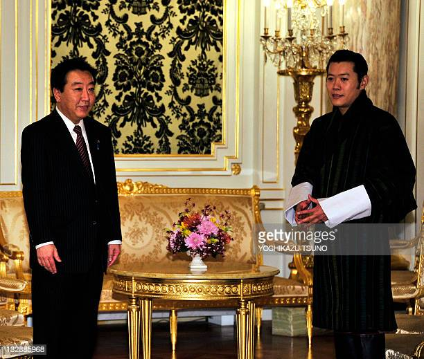 Japanese Prime Minister Yoshihiko Noda is greeted by Bhutan's King Jigme Khesar Namgyel Wangchuck for their talks at the Akasaka guesthouse in Tokyo...