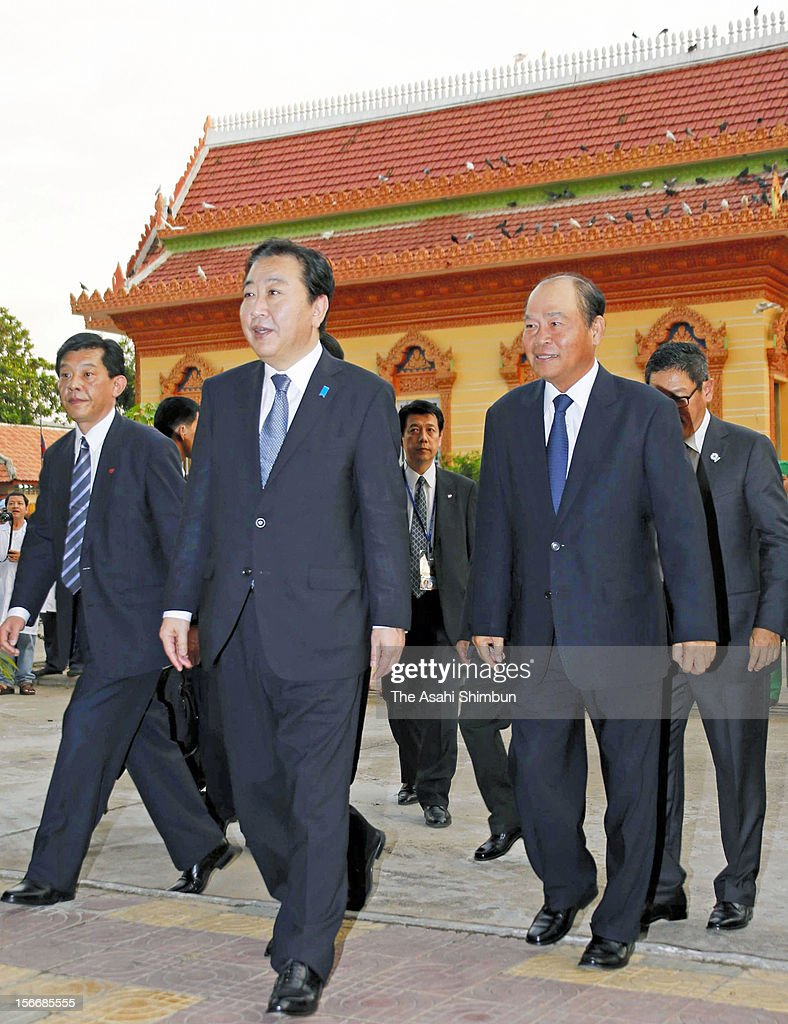 Japanese Prime Minister Yoshihiko Noda (C) is seen upon arrival at the national Kossamak Hospital on November 18, 2012 in Phnom Penh, Cambodia. PM Noda is in Combodia to attend the ASEAN (Association of South]East Asian Nations) meeting, also to meet U.S. president Barack Obama and attend the East Asian Summit.
