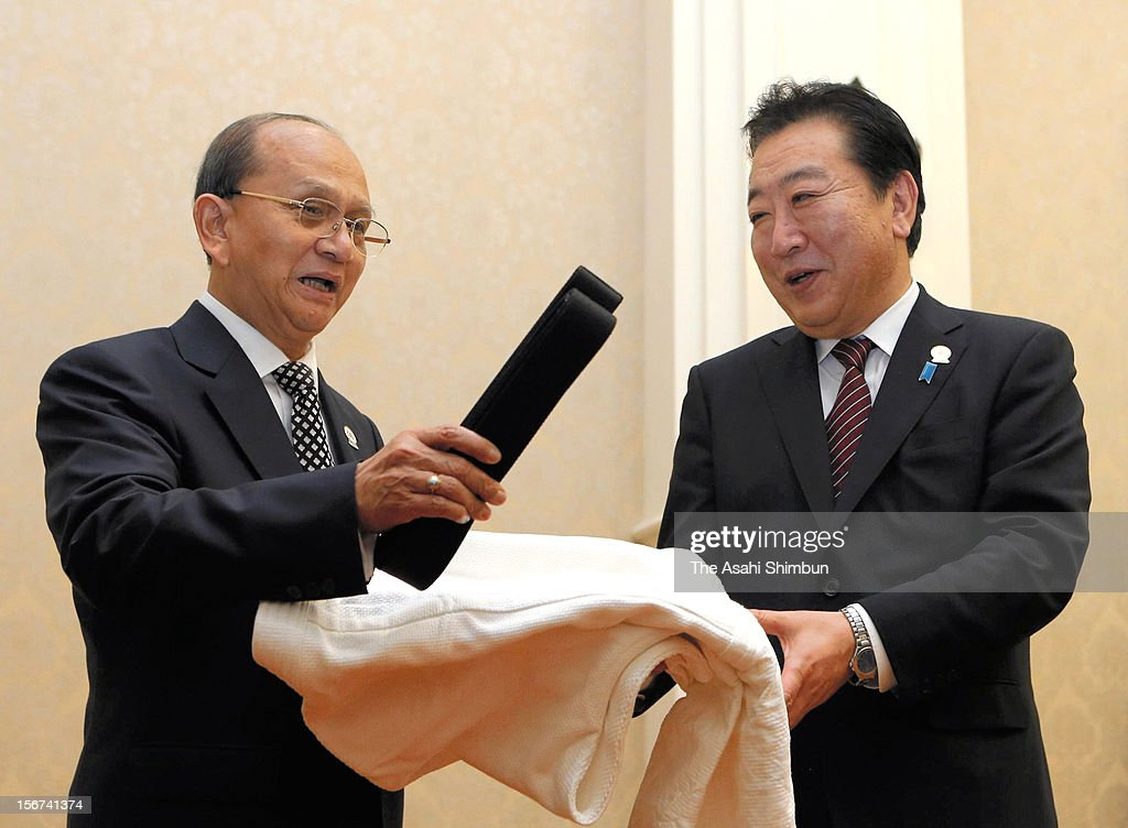 Japanese Prime Minister Yoshihiko Noda presentes judo uniform to Myanmar Presindent Thein Sein during their bilateral meeting on November 18, 2012 in Phnom Penh, Cambodia. Japan will provide new yen loans worth about 50 billion yen to Myanmar from next spring.
