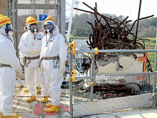 Japanese Prime Minister Yoshihiko Noda wearing radiation protection gears inspects crippled Tokyo Electric Power Co Fukushima Daiichi Nuclear Power...
