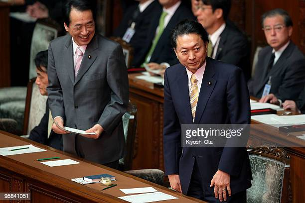 Japanese Prime Minister Yukio Hatoyama and Deputy Prime Minister and Finance Minister Naoto Kan leave after attending the 174th ordinary Diet session...