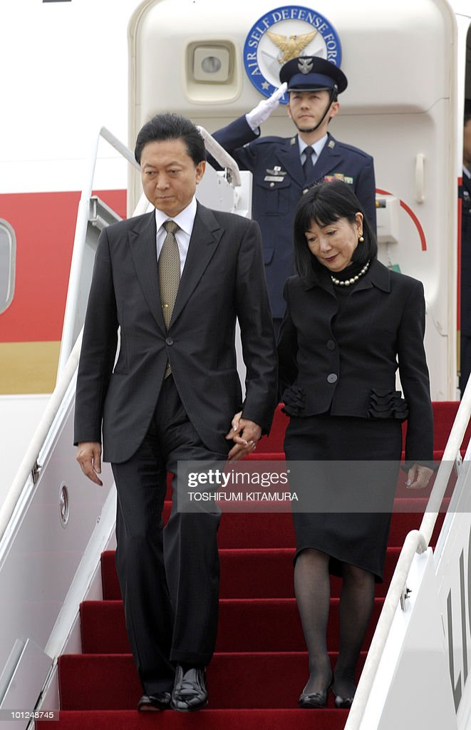 Japanese Prime Minister Yukio Hatoyama (L) and his wife Miyuki (R) arrive at South Korea's air force base in Seoul on May 29, 2010. Hatoyama, Chinese Premier Wen Jiabao and South Korean President Lee Myung-Bak will meet in a three-way summit, amid high tensions on the Korean peninsula. The two-day talks on the South Korean holiday island of Jeju are likely to focus on China's ally North Korea after an investigation found Pyongyang was responsible for the sinking of a South Korean warship that left 46 dead.