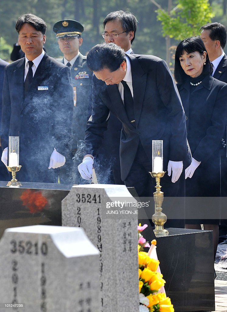 Japanese Prime Minister Yukio Hatoyama (C) burns incense for the 46 sailors who killed in March, sinking of a South Korean warship, at a national cemetery in Daejeon, south of Seoul, on May 29, 2010. Hatoyama arrived in South Korea for a two-day stay to attend an annual summit with the leaders of South Korea and China.