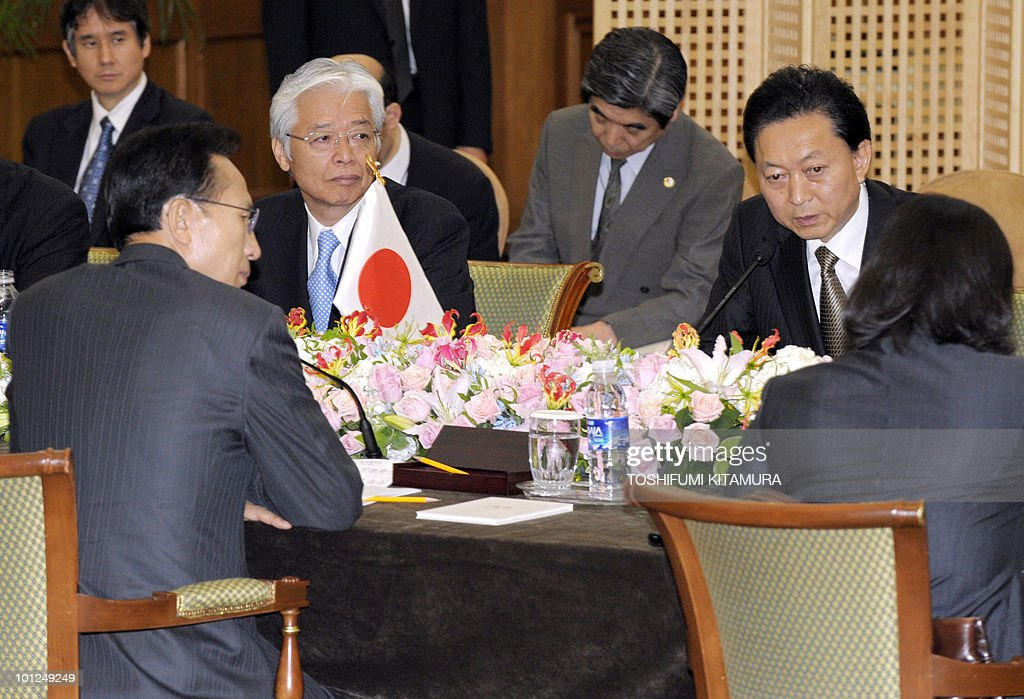 Japanese Prime Minister Yukio Hatoyama (top R) delivers the opening speech during a meeting with South Korean President Lee Myung-Bak (L) at a hotel in Seogwipo city, Jeju island, on May 29, 2010. Hatoyama, Chinese Premier Wen Jiabao and South Korean President Lee Myung-Bak will meet in a three-way summit, amid high tensions on the Korean peninsula. The two-day talks on the South Korean holiday island of Jeju are likely to focus on China's ally North Korea after an investigation found Pyongyang was responsible for the sinking of a South Korean warship that left 46 dead.