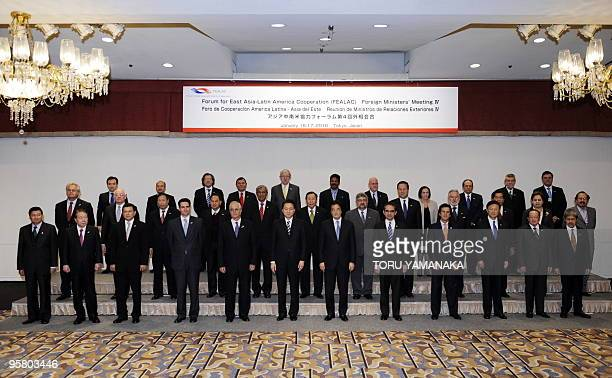 Japanese Prime Minister Yukio Hatoyama poses with foreign ministers from East Asia and Latin America at a photo session at the opening session of the...