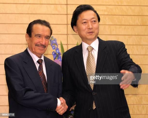 Japanese Prime Minister Yukio Hatoyama shakes hands with Saudi Economy and Planning Minister Khalid bin Muhammad alQusaybi at Hatoyama's official...