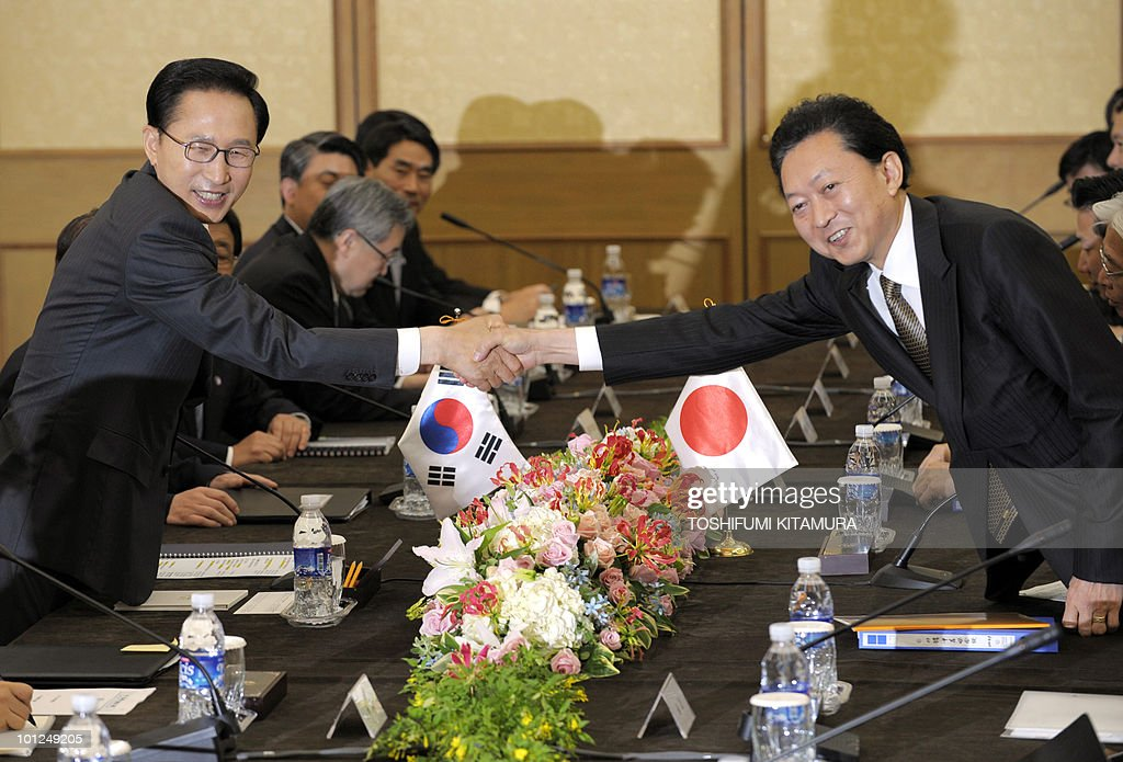 Japanese Prime Minister Yukio Hatoyama (R) shakes hands with South Korean President Lee Myung-Bak (L) prior to talks at a hotel in Seogwipo city, Jeju island, on May 29, 2010. Hatoyama, Chinese Premier Wen Jiabao and South Korean President Lee Myung-Bak will meet in a three-way summit, amid high tensions on the Korean peninsula. The two-day talks on the South Korean holiday island of Jeju are likely to focus on China's ally North Korea after an investigation found Pyongyang was responsible for the sinking of a South Korean warship that left 46 dead.