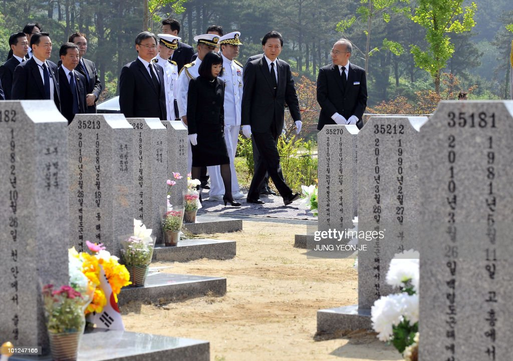 Japanese Prime Minister Yukio Hatoyama (2R) visits the national cemetery to pay homage to the 46 sailors killed in the March, sinking of a South Korean warship, in Daejeon, south of Seoul, on May 29, 2010. Hatoyama arrived in South Korea for a two-day stay to attend an annual summit with the leaders of South Korea and China.