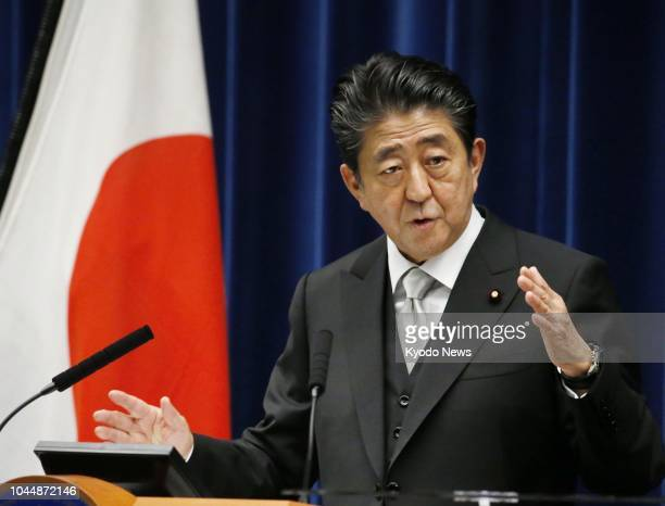 Japanese Prime Minster Shinzo Abe speaks at a news conference at the prime minister's office in Tokyo on Oct 2 following the launch of his reshuffled...