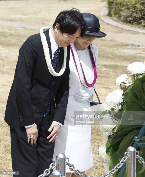 Japanese Prince Akishino and his wife Princess Kiko observe a moment of silence in Honolulu on June 4 in front of a monument dedicated to nine people...
