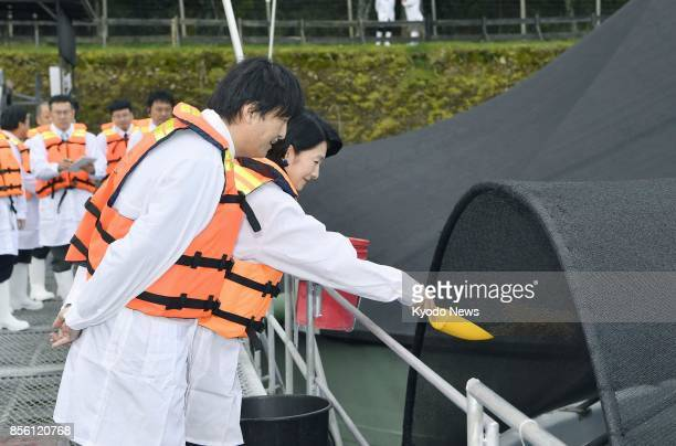 Japanese Prince Akishino and his wife Princess Kiko visit a salmon farm in La Union southern Chile on Sept 30 during their 10day trip to the South...