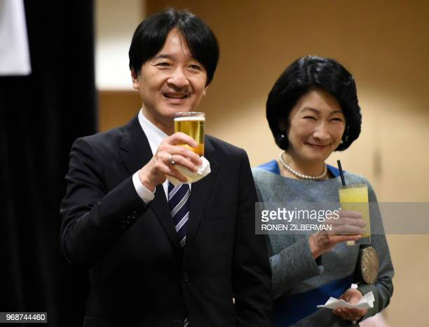 Japanese Prince Akishino and Princess Kiko hold up their glasses for a toast at the Nikkei Japanese Abroad reception in Honolulu Hawaii on June 6...