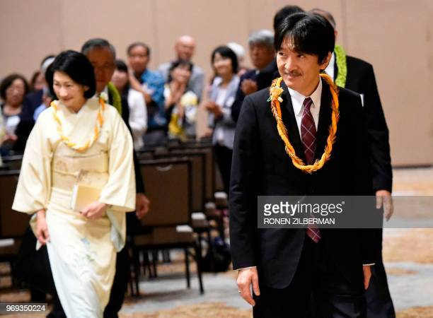 Japanese Prince Akishino and Princess Kiko look on during the opening of the 150th anniversary of the Gannemono Symposium in Honolulu Hawaii June 6...