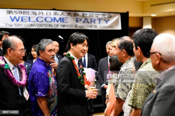 Japanese Prince Akishino greets members of the community during the Nikkei Japanese Abroad reception in Honolulu Hawaii on June 6 during their visit...