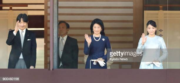 Japanese Prince Akishino his wife Princess Kiko and their daughter Princess Mako wave to wellwishers at the Imperial Palace in Tokyo on Jan 2 2018...