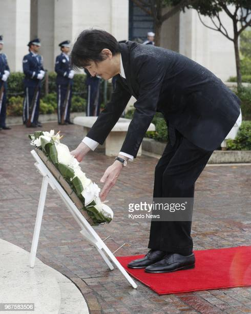 Japanese Prince Akishino offers a wreath at the National Memorial Cemetery of the Pacific in Honolulu which commemorates soldiers who died during...