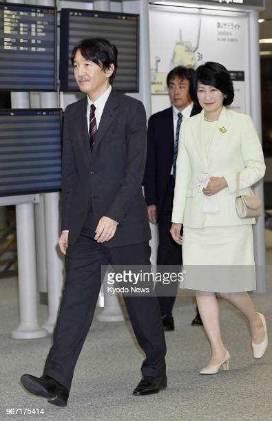 Japanese Prince Akishino the second son of Emperor Akihito and his wife Princess Kiko head to the gate at Narita airport east of Tokyo on June 4 2018...