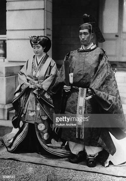 Japanese Prince and Princess in the ceremonial costume of a Japanese wedding ceremony in 1884