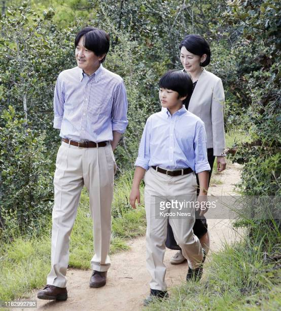 Japanese Prince Hisahito and his parents Crown Prince Fumihito and Crown Princess Kiko pose for a photo on a hiking trail in Thimphu the capital of...