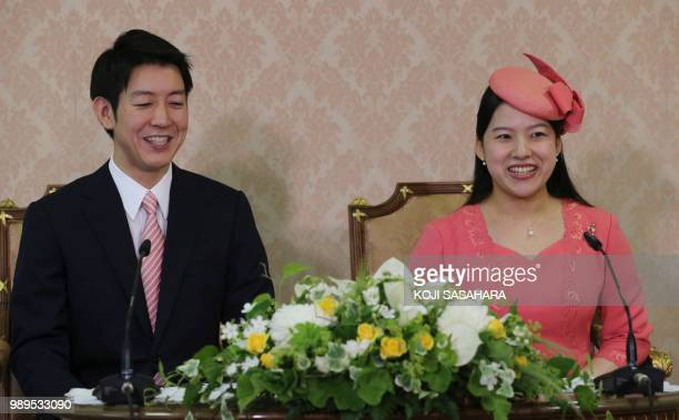 Japanese Princess Ayako the third daughter of the late Prince Takamado and her fiance Kei Moriya attend a press conference to announce their...