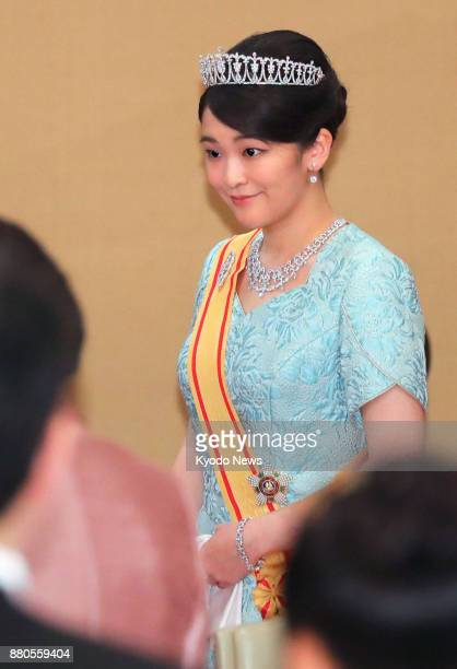 Japanese Princess Mako attends a banquet hosted by Emperor Akihito and Empress Michiko at the Imperial Palace in Tokyo on Nov 27 2017 for...