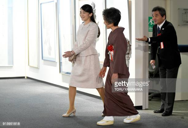 Japanese Princess Mako is escorted by calligrapher Hakuyo Kaneoka during a visit to a calligraphy exhibition in Tokyo on February 9 2018 The...