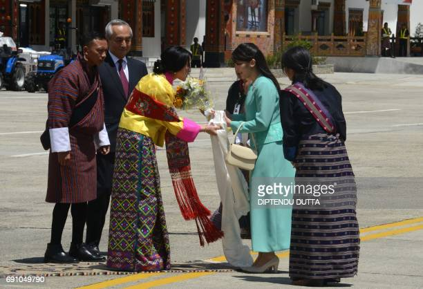 Japanese Princess Mako is welcomed by Bhutan's Princess Euphelma at Paro International Airport in Paro on June 1 at the start of her nineday official...