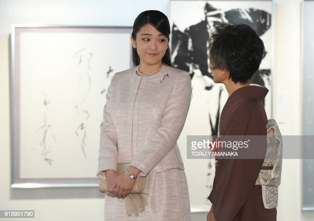 Japanese Princess Mako listens as calligrapher Hakuyo Kaneoka speaks about a calligraphy exhibition in Tokyo on February 9 2018 The engagement and...