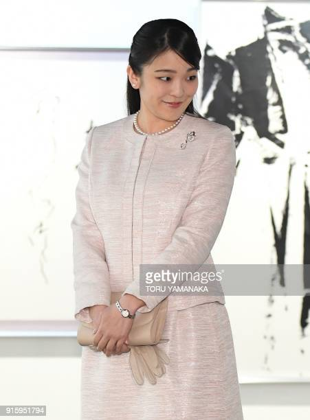Japanese Princess Mako listens to a calligrapher during a visit to a calligraphy exhibition in Tokyo on February 9 2018 The engagement and wedding of...