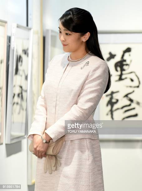 Japanese Princess Mako looks at works during a visit to a calligraphy exhibition in Tokyo on February 9 2018 The engagement and wedding of Princess...