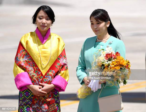 Japanese Princess Mako of Akishino is welcomed by Princess Eeuphelma Choden Wangchuck on arrival at Paro International Airport on June 1 2017 in Paro...