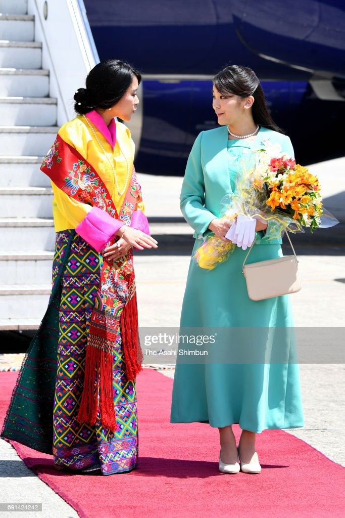 Japanese Princess Mako of Akishino (R) is welcomed by Princess Eeuphelma Choden Wangchuck (L) on arrival at Paro International Airport on June 1, 2017 in Paro, Bhutan.