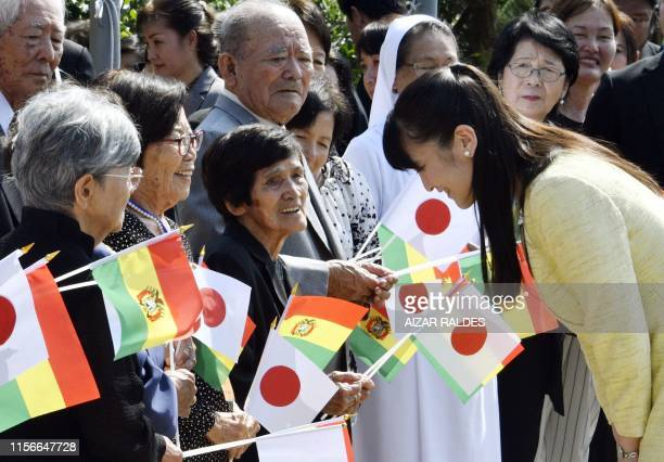 Japanese Princess Mako, the eldest daughter of Crown Prince Akishino, greets locals during celebrations for the 120th anniversary of the Japanese...