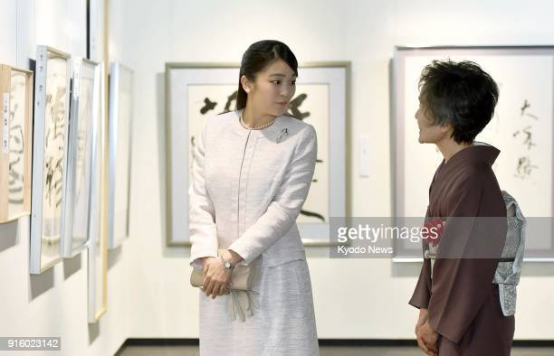 Japanese Princess Mako the eldest granddaughter of Emperor Akihito visits a calligraphy exhibition in Tokyo on Feb 9 in her first official duty since...