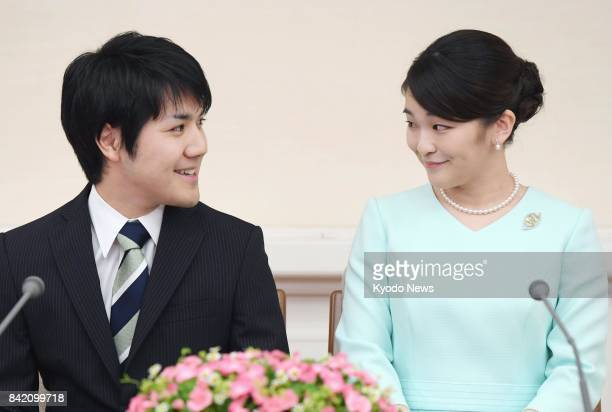 Japanese Princess Mako the eldest granddaughter of Emperor Akihito and Empress Michiko and her longtime boyfriend Kei Komuro look at each other...