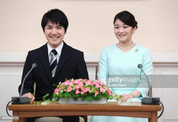 Japanese Princess Mako the eldest granddaughter of Emperor Akihito and Empress Michiko and her longtime boyfriend Kei Komuro smile during a news...