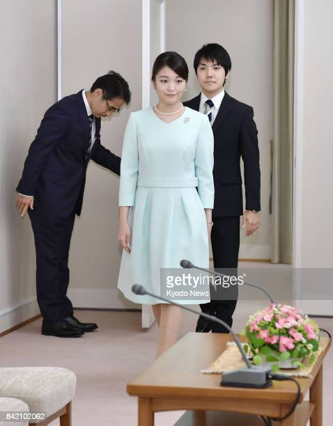 Japanese Princess Mako the eldest granddaughter of Emperor Akihito and Empress Michiko and her longtime boyfriend Kei Komuro attend a news conference...