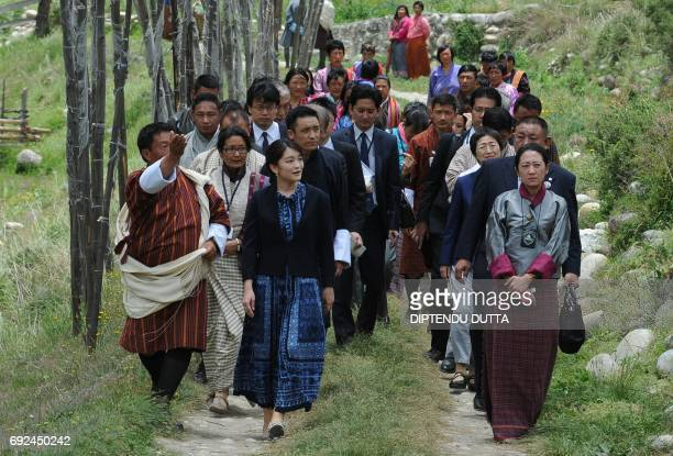 Japanese Princess Mako walks through a farming area in Chukha village on the outskirts of Paro on her visit to Bhutan on June 5 2017 Japanese...